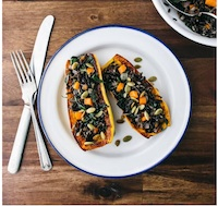 Stuffed Delicata Squash with Wild Rice, Brown Butter, and Sage
