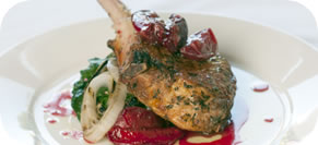 Grilled Kurobuta Pork Loin Chop with Sweet Onions, Sauteed Greens & Ca
