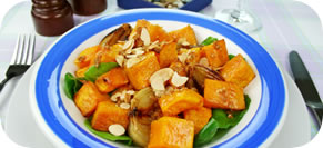 Roasted Winter Squash and Spinach Salad with Toasted Almond Dressing
